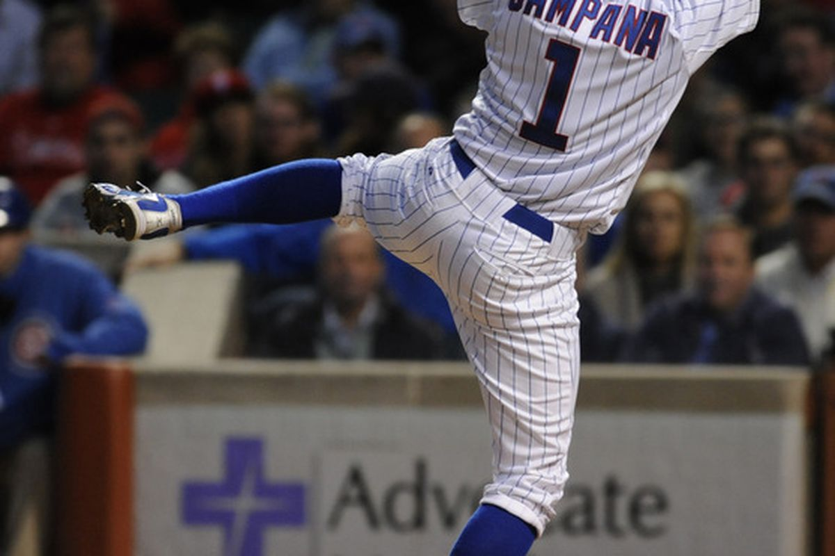 Write your own caption: Tony Campana of the Chicago Cubs gets out of the way of an inside pitch against the Philadelphia Phillies at Wrigley Field in Chicago, Illinois.  (Photo by David Banks/Getty Images)