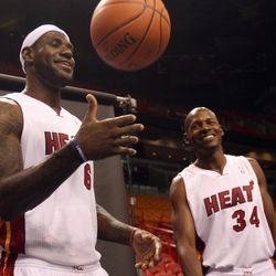 Miami Heat basketball players LeBron James, left,  and Ray Allen wait for their turn to have their pictures taken during the team's NBA media day in Miami, Friday, Sept. 28, 2012.
