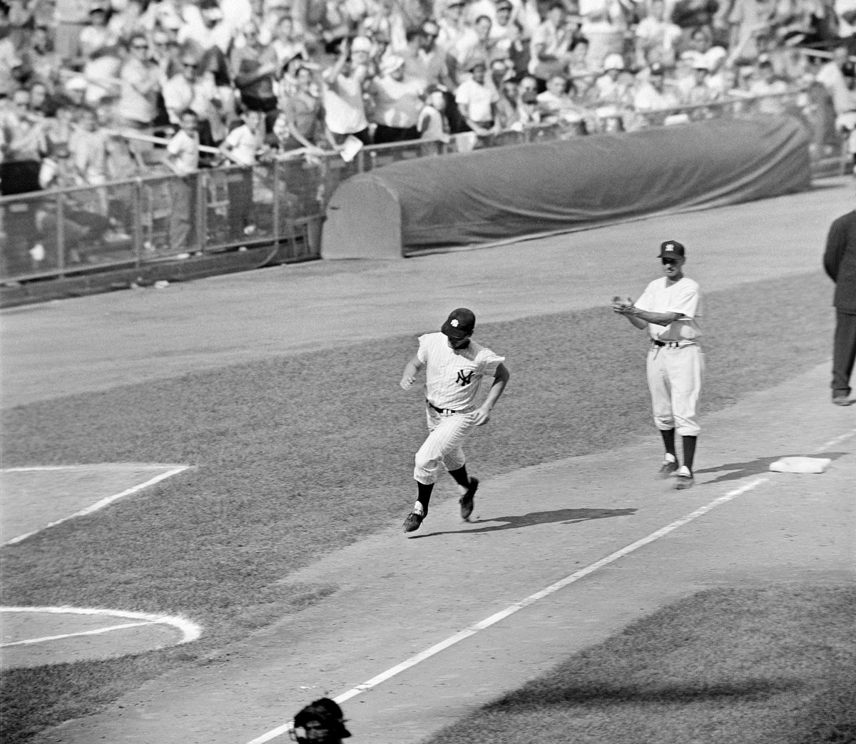Roger Maris heads for home after hitting his record-breaking 61st home run in 1961.