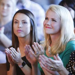 Elizabeth Smart and Bre Lasley listen to their introduction during Fight Like Girls intro night at in Salt Lake City Thursday, June 23, 2016.