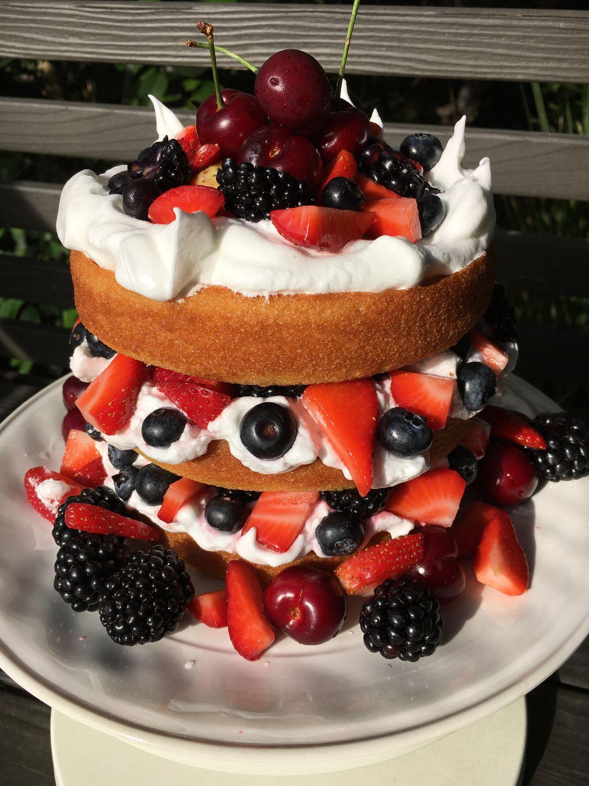 Buttermilk cake with fresh berries. | COURTESY WAYLYNN LUCAS/ FOOD NETWORK