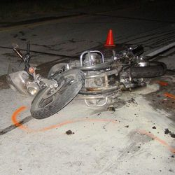 A motorcycle lies alongside I-15 in Box Elder County after it hit a mattress Monday night, June 4, 2012. The rider died as a result of the accident.