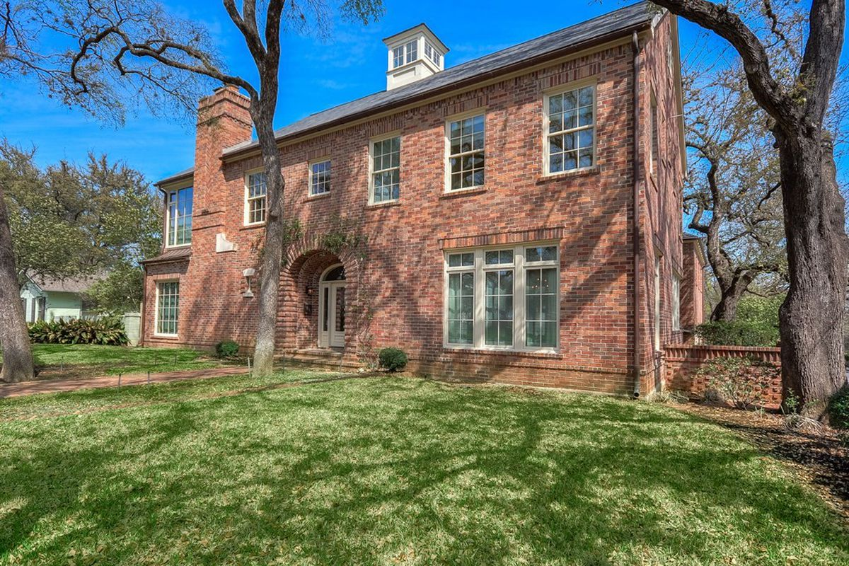 Large, traditional, two story brick house