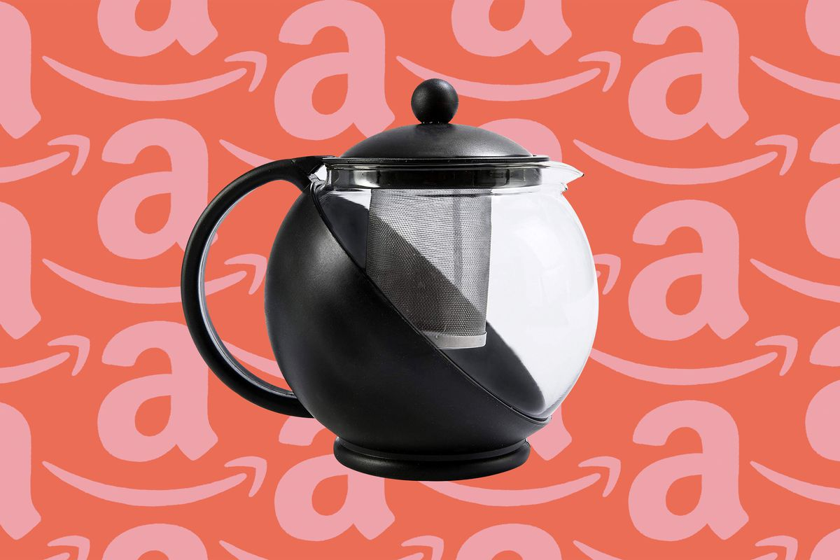 A clear and black flowering teapot is set against a red and pink Amazon print.