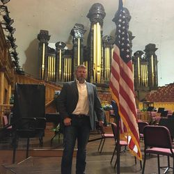"""Mark Geist, a member of the Benghazi Annex security team and co-author of """"13 Hours"""" poses in the Mormon Tabernacle on Temple Square during a September 2016 tour with Donald Trump Jr. that led to an invitation from President-elect Donald Trump for the Mormon Tabernacle Choir to perform at Trump's inauguration on Jan. 20, 2017."""