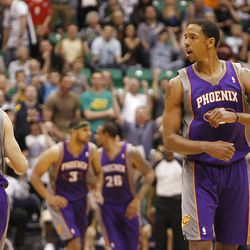 Sun's Channing Frye celebrates a three point shot in the final minute  in the final minute as the Utah Jazz are defeated by the Phoenix Suns 107-105 as they play NBA basketball Wednesday, April 4, 2012, in Salt Lake City, Utah.
