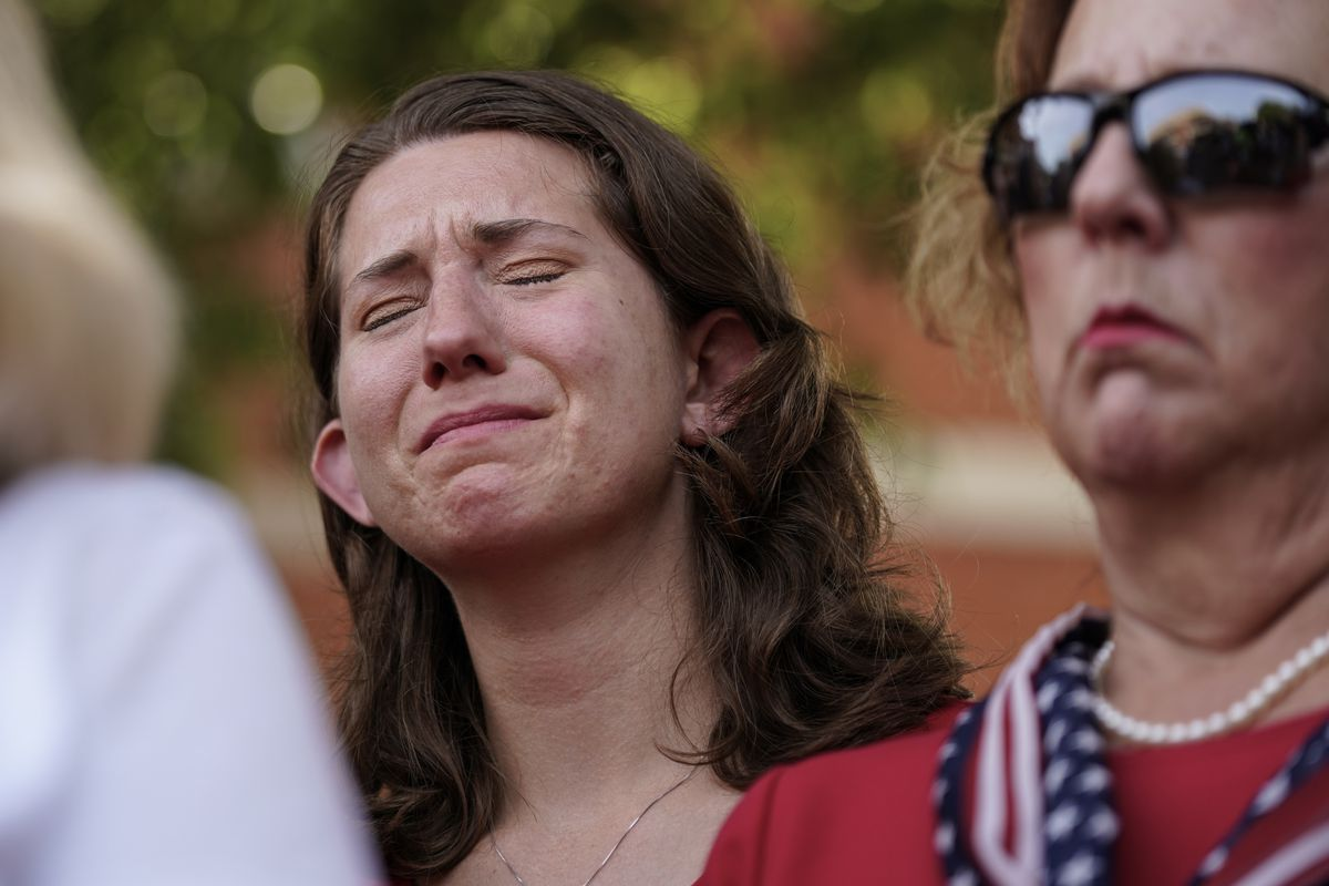 Montana Geimer, daughter of Wendi Winters, a community beat reporter who died in the Capital Gazette newsroom shooting, reacts during a press conference following a verdict in the trial of Jarrod W. Ramos, Thursday, July 15, 2021, in Annapolis, Md.