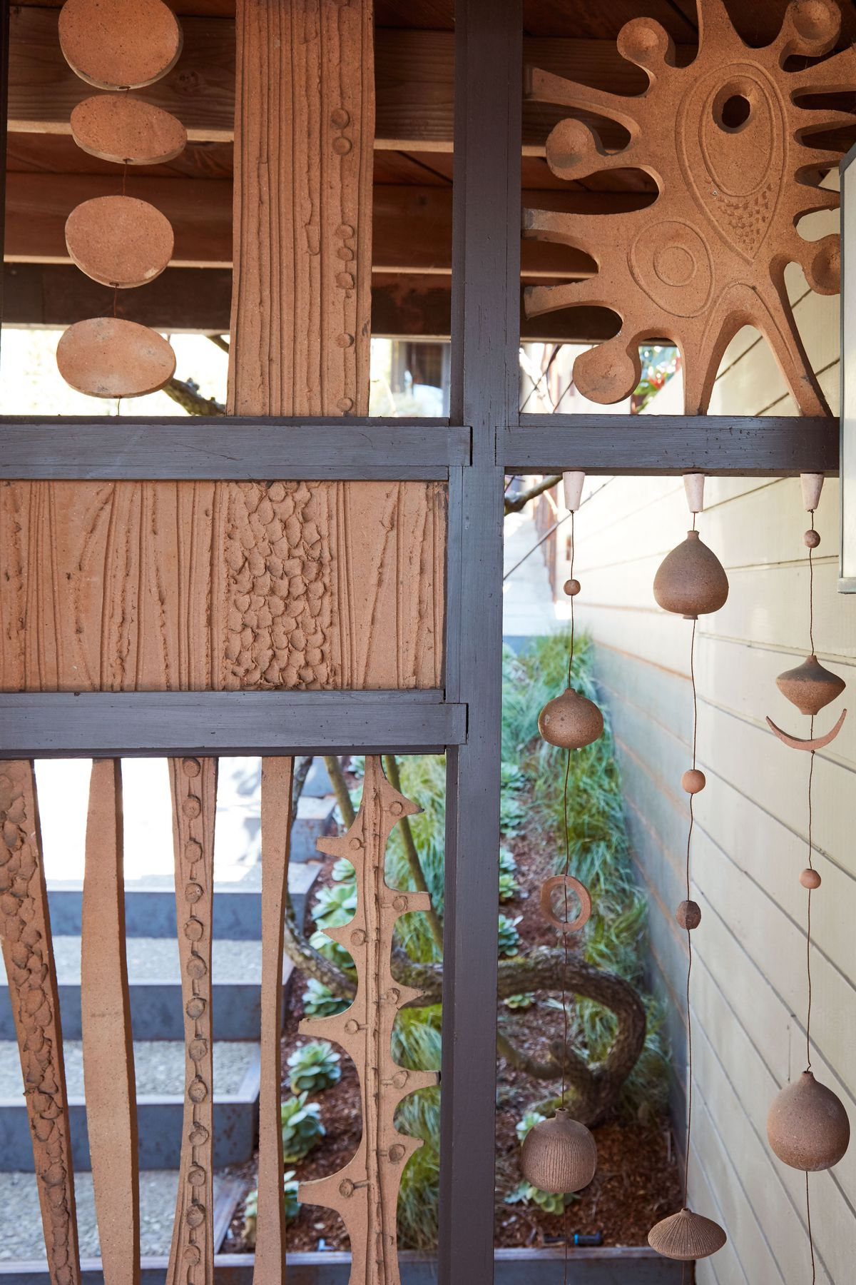 An entryway. There are ceramic cutouts in the partition in the entryway.