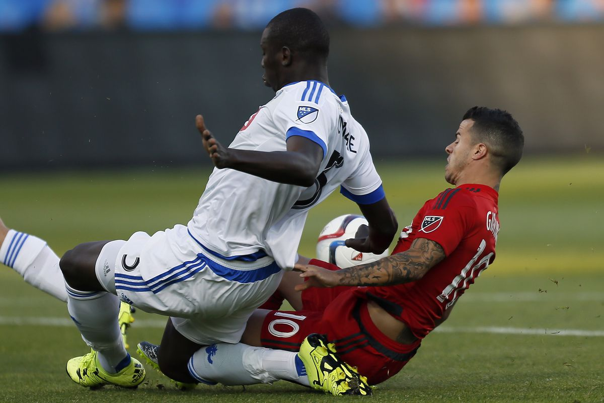 Soumare takes down Giovinco in the box in IMFC 3-1 loss on Wednesday.