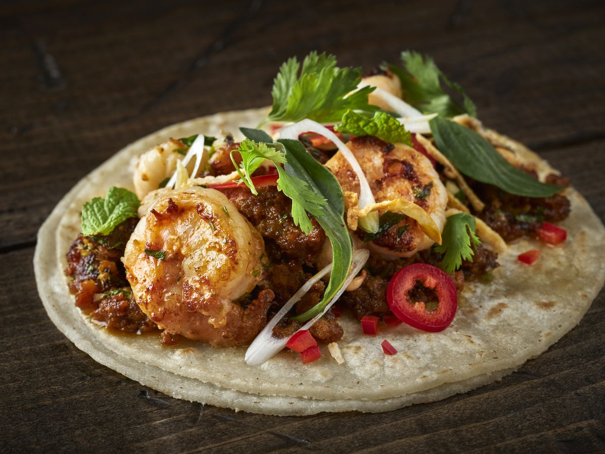 A One Night in Bangkok taco incorporates Thai flavors with seared shrimp and chorizo larb, mint, basil, chiles, and crispy onions.