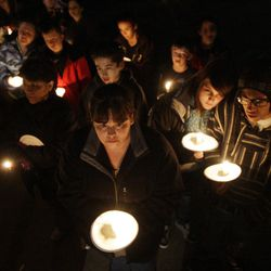 Kimberly Williams along with Powell family friends and well wishers hold a candlelight vigil in Salt Lake County  Sunday, Feb. 5, 2012. Josh Powell and his two sons were killed in an explosion in Washington.