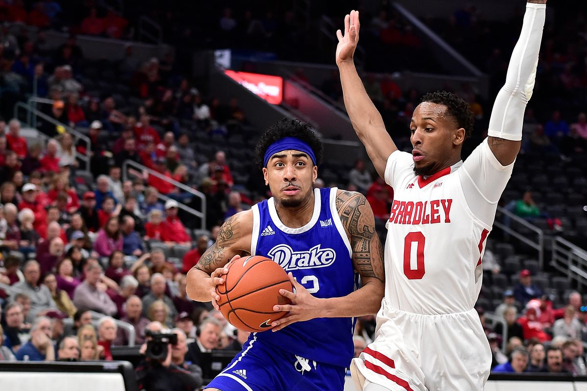 Drake Bulldogs guard Roman Penn drives to the basket as Bradley Braves guard Danya Kingsby defends during the first half at Enterprise Center.