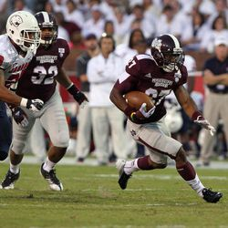 Mississippi State running back LaDarius Perkins, right, pulls away from a pack of South Alabama defenders on his way to a 44-yard touchdown run in the first half of an NCAA college football game on Saturday, Sept. 22, 2012, in Starkville, Miss.