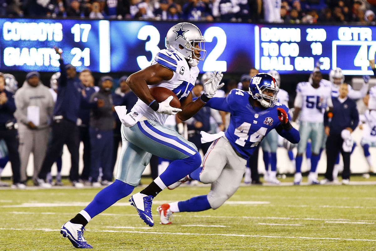 Barry Church sets sail with an interception of a rare Bad Eli pass on Sunday night.