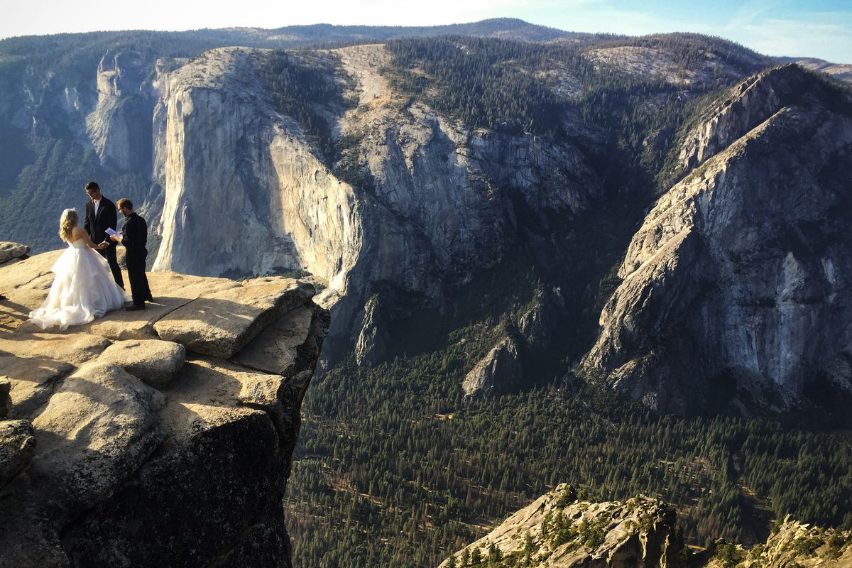 September 27: A couple gets married at Taft Point in California's Yosemite National Park. The viewpoint overlooks Yosemite Valley, including El Capitan, a popular vertical ascent for rock climbers across the globe. (Amanda Lee Myers/AP)