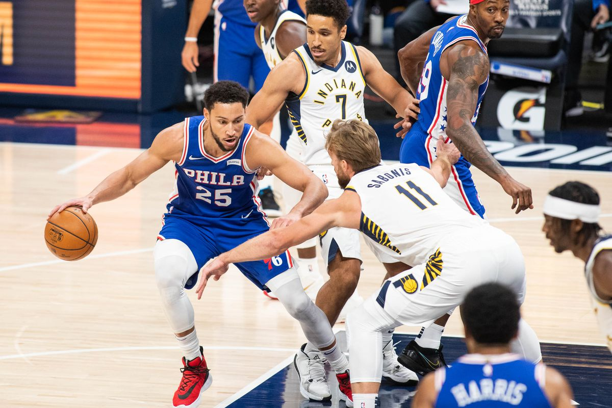 Philadelphia 76ers guard Ben Simmons (25) dribbles the ball while Indiana Pacers forward Domantas Sabonis (11) defends in the first quarter at Bankers Life Fieldhouse.