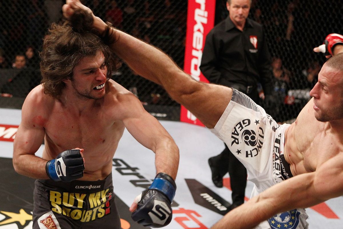 LAS VEGAS - JANUARY 07: Tarec Saffiedine (right) kicks Tyler Stinson during the Strikeforce event at the Hard Rock Hotel and Casino on January 7, 2012 in Las Vegas, Nevada. (Photo by Esther Lin/Forza LLC/Forza LLC via Getty Images)