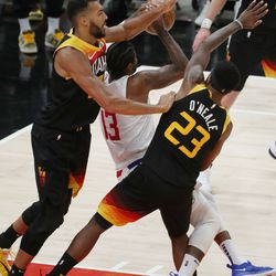 Utah Jazz center Rudy Gobert (27) and Utah Jazz forward Royce O'Neale (23) denied LA Clippers guard Paul George (13) during the NBA playoffs in Salt Lake City on Thursday, June 10, 2021. The Jazz won 117-111.
