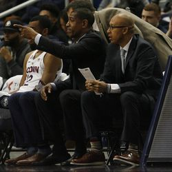 UConn head coach Kevin Ollie points out something on the defensive end of the floor.