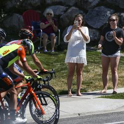 Women cheer on racers as they pass by during Stage 3 of the Tour of Utah in North Salt Lake on Thursday, Aug. 15, 2019.