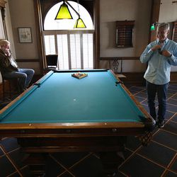 Libertarian presidential candidate Gov. Gary Johnson, right, and running mate Gov. Bill Weld take a few minutes to relax at the Alta Club in Salt Lake City before giving a speech at the University of Utah on Saturday, Aug. 6, 2016.
