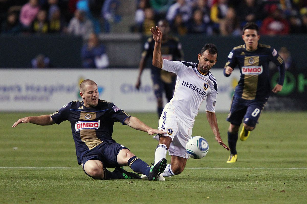 CARSON, CA - APRIL 02:  Juninho #19 of the Los Angeles Galaxy defends a tackle during the Philadelphia Union v Los Angeles Galaxy Match at The Home Depot Center on April 2, 2011 in Carson, California.  (Photo by Joe Scarnici/Getty Images)