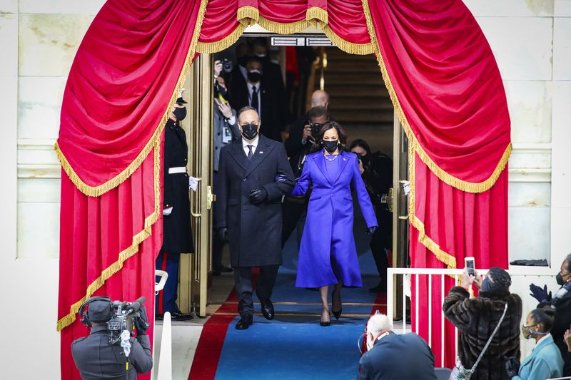 Vice President Kamala Harris with her husband, Doug Emhoff, arrive at the inauguration ceremony.