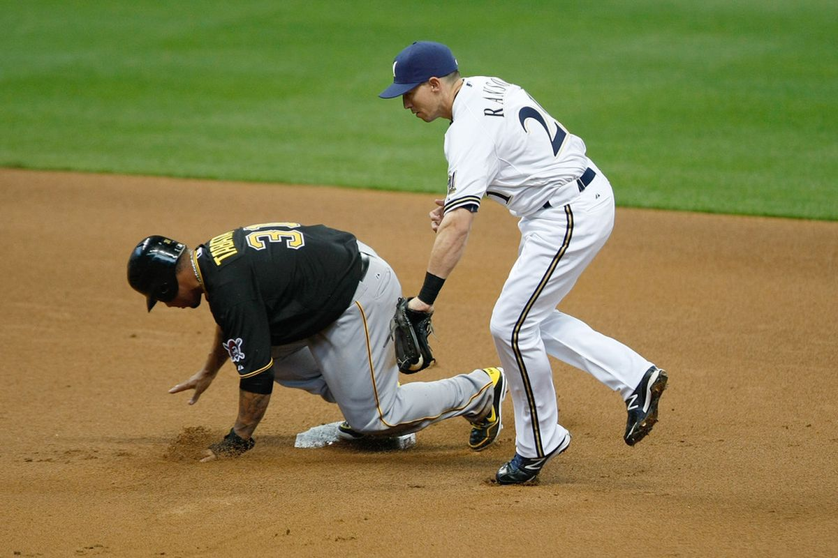 MILWAUKEE, WI - JUNE 01: Jose Tabata #31 of the Pittsburgh Pirates slides into second base as Cody Ranson #21 of the Milwaukee Brewers attempts the tag at Miller Park on June 1, 2012 in Milwaukee, Wisconsin. (Photo by Scott Boehm/Getty Images)