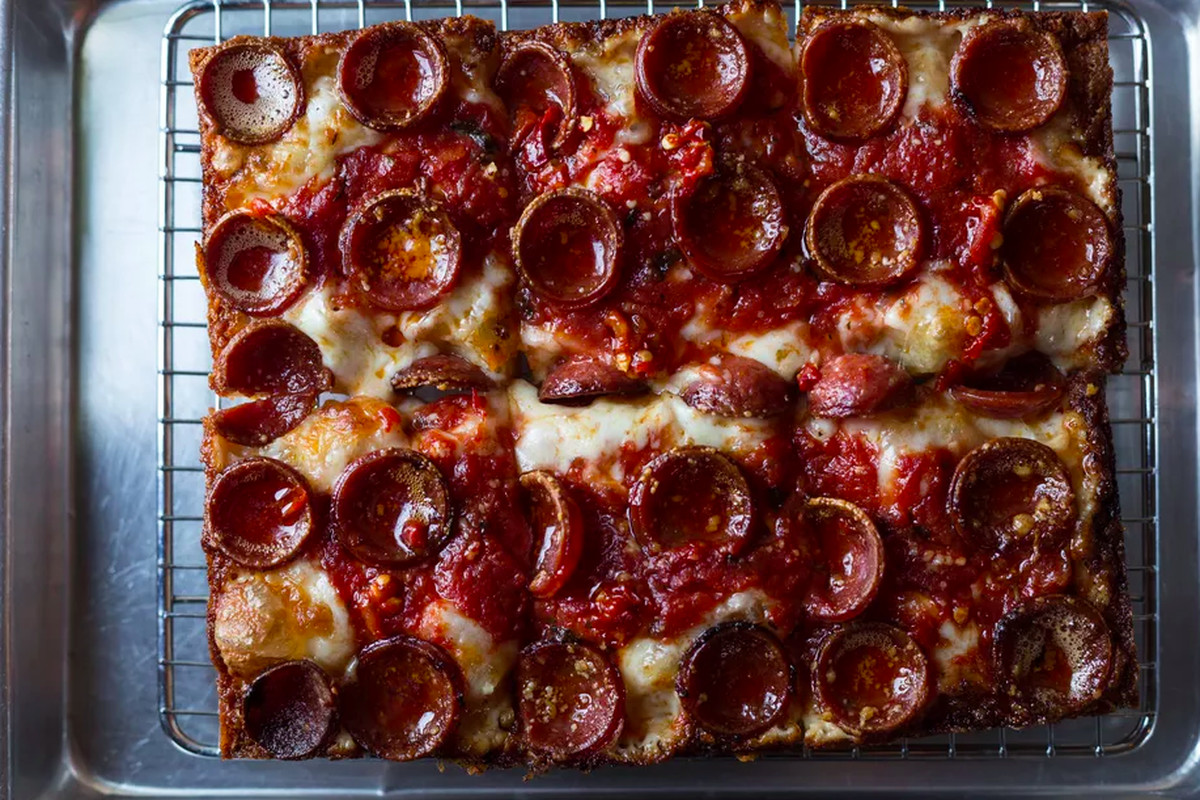 Overhead view of a rectangular pan pizza, Detroit-style, with pepperoni