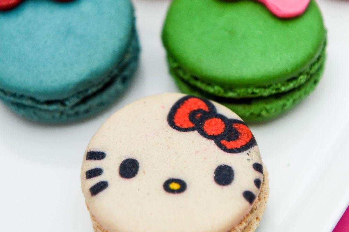 a macaron decorated like Hello Kitty