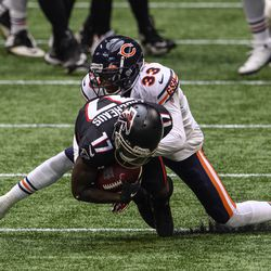 Chicago Bears cornerback Jaylon Johnson (33) tackles Atlanta Falcons wide receiver Olamide Zaccheaus (17) during the first half of an NFL football game, Sunday, Sept. 27, 2020, in Atlanta.