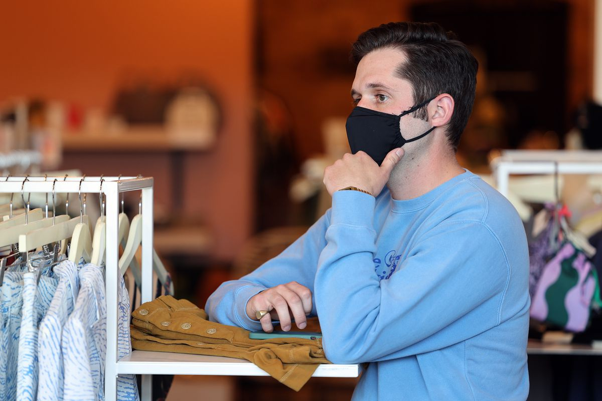 Josh Edgar, an employee at the Stockist store in Salt Lake City, talks with store owner Helen Wade and another employee, Jack Carrasco, on Sunday, April 11, 2021.