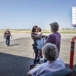 Wendell Ashcroft, left, is the last one to join his waiting family as Danielle Garrick hugs her 4-year-old daughter, Malloy, at Skydive Ogden in Ogden on Saturday, Aug. 5, 2017.