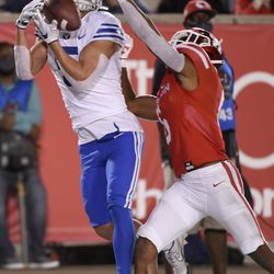 BYU wide receiver Dax Milne, left, catches a touchdown pass as Houston cornerback Damarion Williams defends during the second half of an NCAA college football game, Friday, Oct. 16, 2020, in Houston.