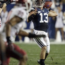 Brigham Young Cougars quarterback Riley Nelson (13) throws  against Washington State in Provo  Thursday, Aug. 30, 2012.