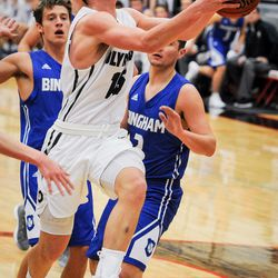 Olympus' Rylan Jones (15) drives for a layup as the Bingham High Miners takes on the Olympus High Titans in a quarterfinal matchup of Utah Elite 8 in American Fork on Thursday, Dec. 7, 2017.