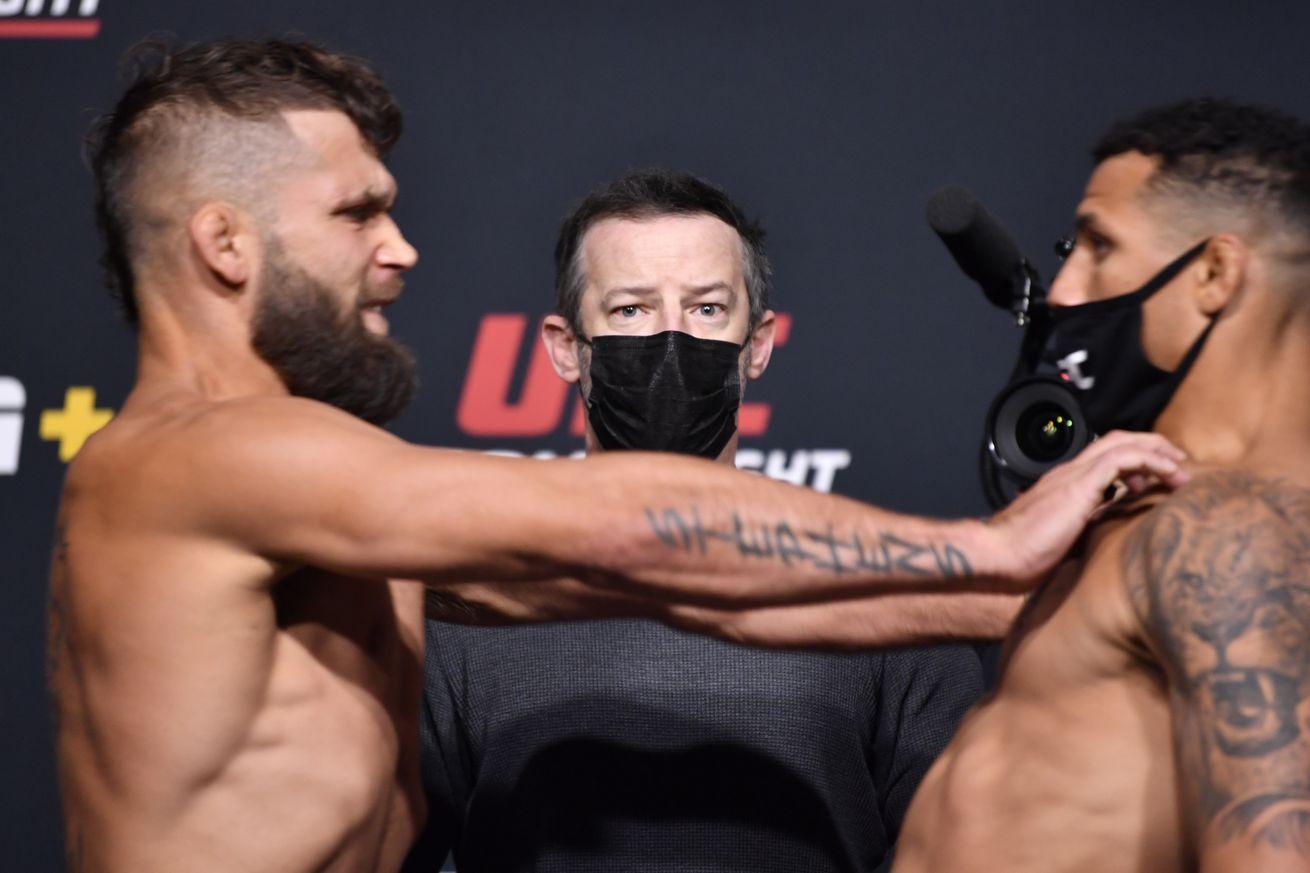 Jeremy Stephens shoves Drakkar Klose at the UFC Vegas 24 weigh-ins.
