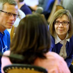 Jay and Jane Griffith listen as another attendee talks as they join with Thomas McConkie of Lower Lights in a group for mediation and discussion in Salt Lake City on Wednesday, June 14, 2017.