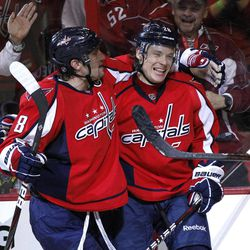 Washington Capitals left wing Alexander Semin, right, celebrates his goal with left wing Alex Ovechkin during the second period of Game 4 in a first-round NHL Stanley Cup playoff hockey series against the Boston Bruins on Thursday, April 19, 2012 in Washington. The Capitals defeated the Bruins 2-1.
