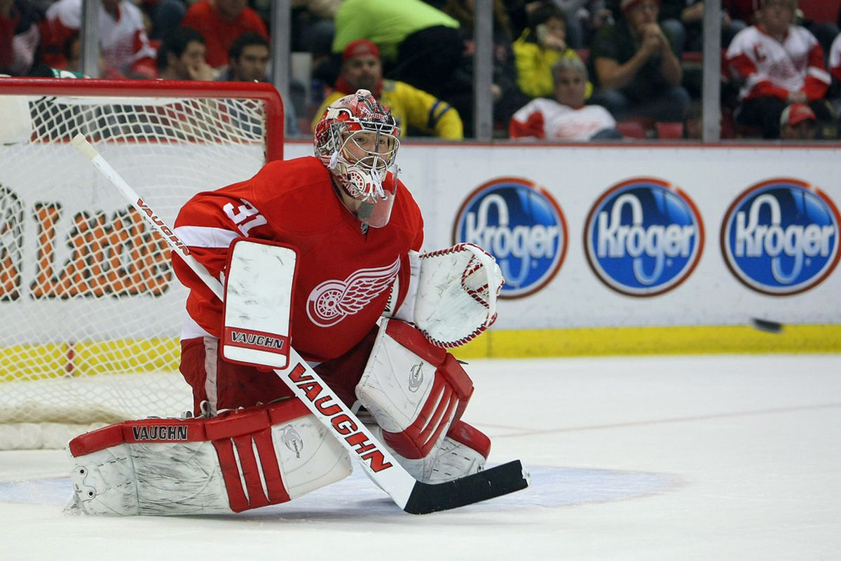 DETROIT, MI - MARCH 4:  Joey MacDonald #31 of the Detroit Red Wings gets set to make a save against the Chicago Blackhawks during their NHL game at Joe Louis Arena on March 4, 2012 in Detroit, Michigan.  (Photo by Dave Sandford/Getty Images)