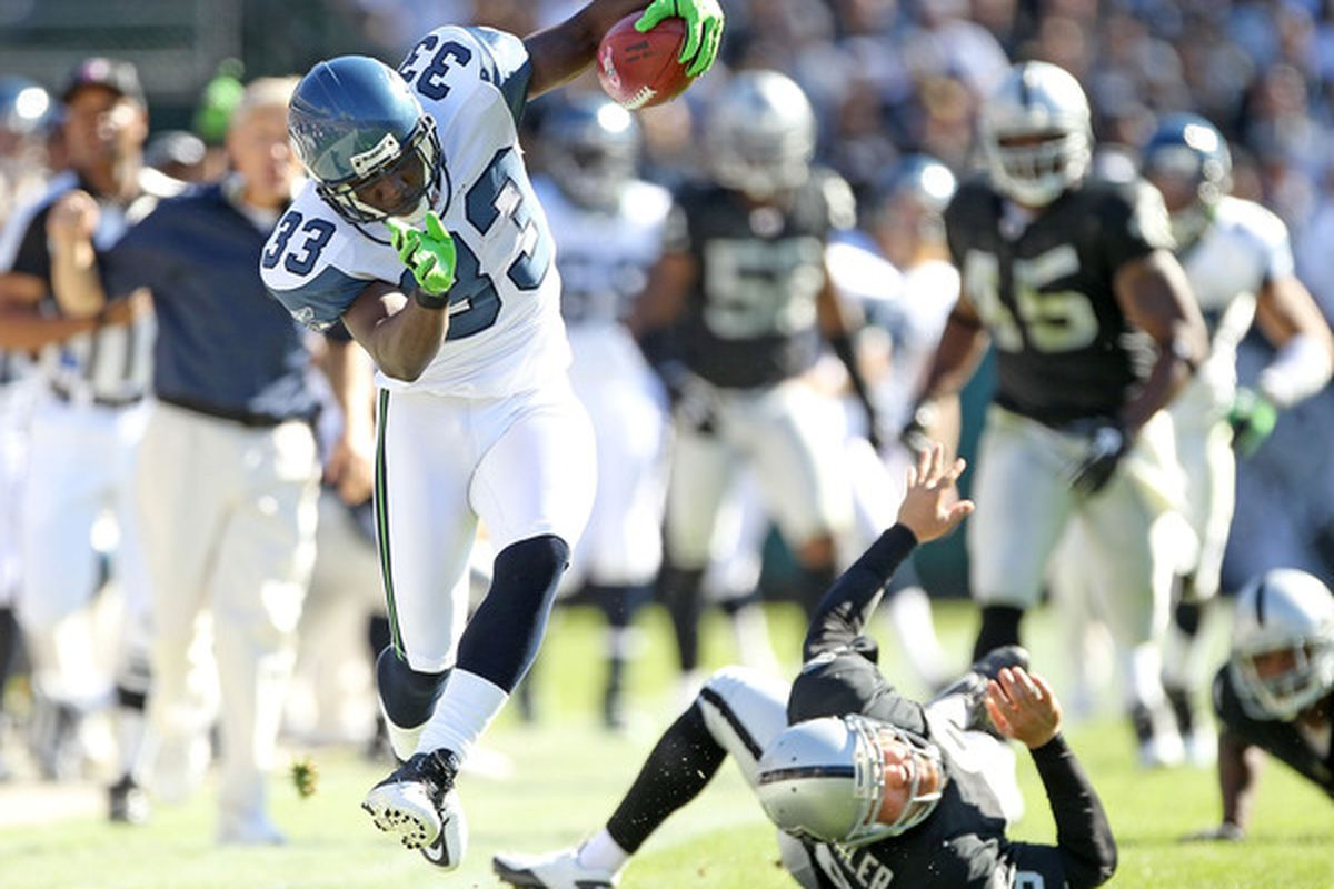 OAKLAND CA - OCTOBER 31:  Leon Washington #33 of the Seattle Seahawks tries to stay in bounds on a punt return against the Oakland Raiders at Oakland-Alameda County Coliseum on October 31 2010 in Oakland California.  (Photo by Ezra Shaw/Getty Images)