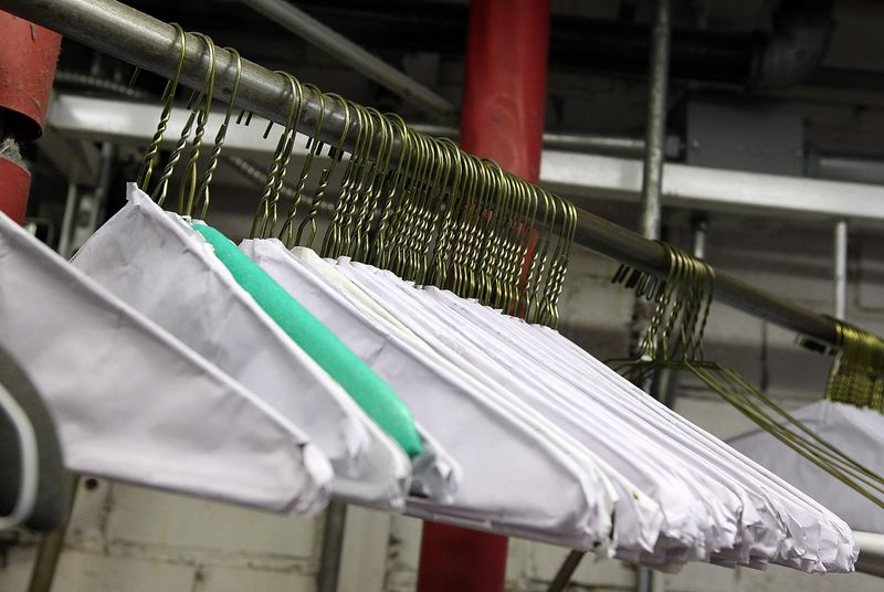 wire hangers hanging in a dry cleaner