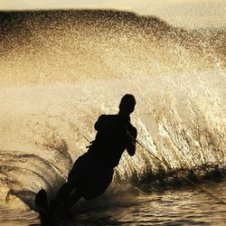 Michael Van Tienderen water skis in the early morning light at Lake Powell Aug. 15, 2006. There has been debate on whether recreation areas and national parks in Utah should be opened and run by the state during the federal government shutdown.