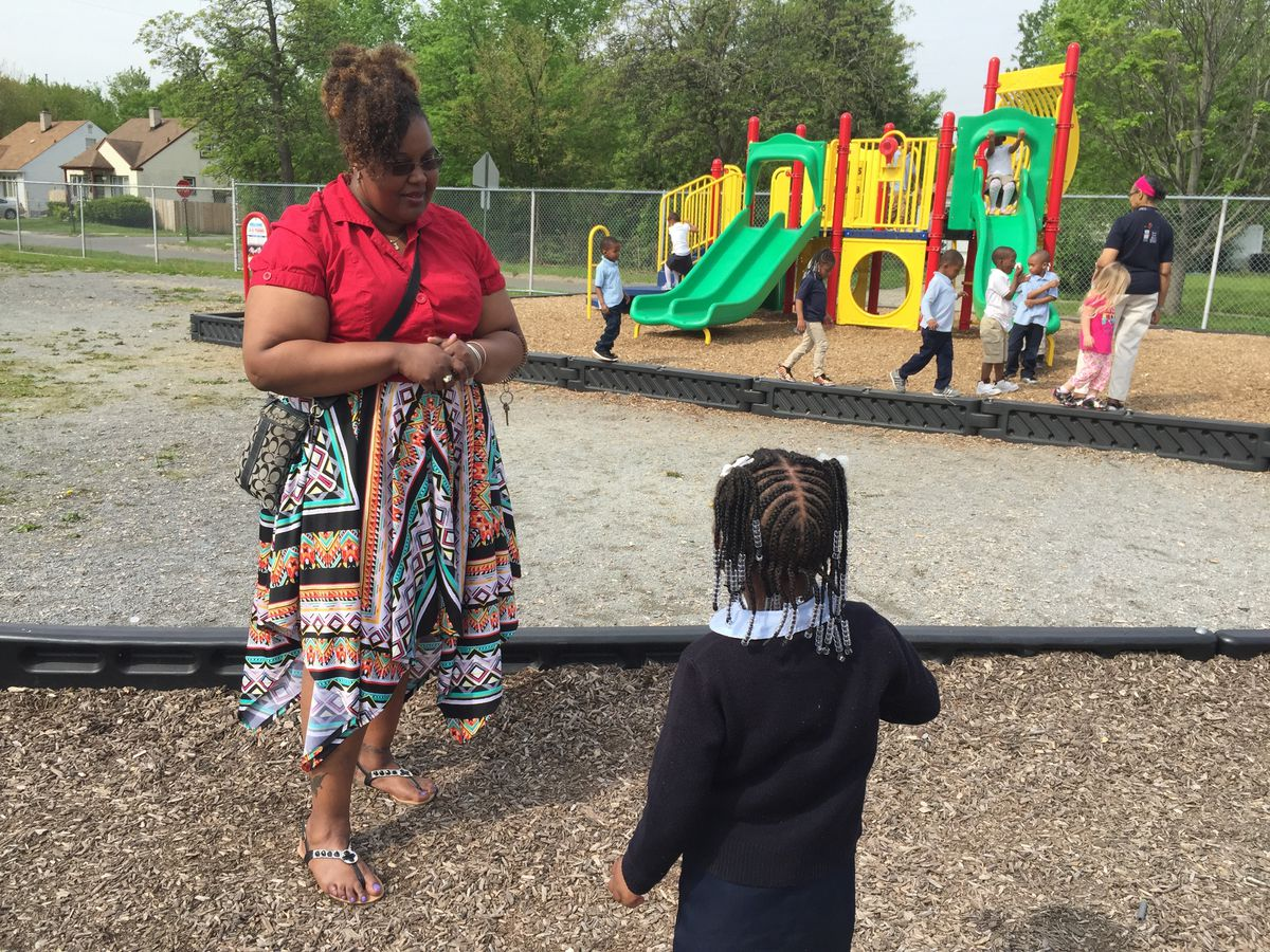 """Detroit Pre-K teacher Candace Graham talks to a student on the playground at the Carver STEM Academy. She says her students get """"left out a lot"""" because the school's two other preschool classrooms are in the PNC Grow Up Great program."""