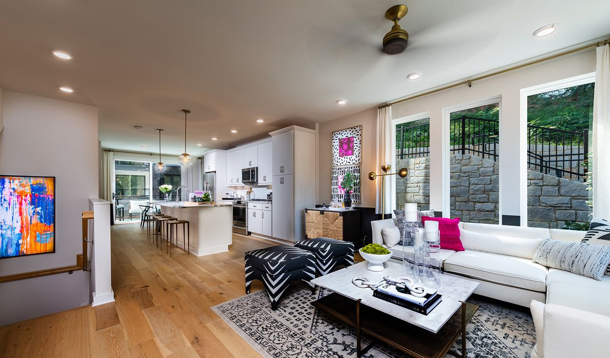 An open floorplan with the living area in the front and kitchen in the back.
