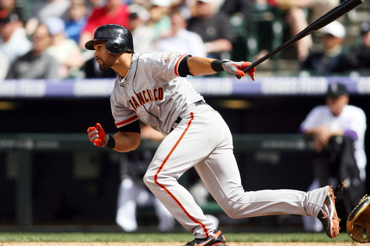 April 12, 2012; Denver, CO, USA; San Francisco Giants center fielder Angel Pagan (16) hits an RBI double during the sixth inning against the Colorado Rockies at Coors Field.  Mandatory Credit: Chris Humphreys-US PRESSWIRE