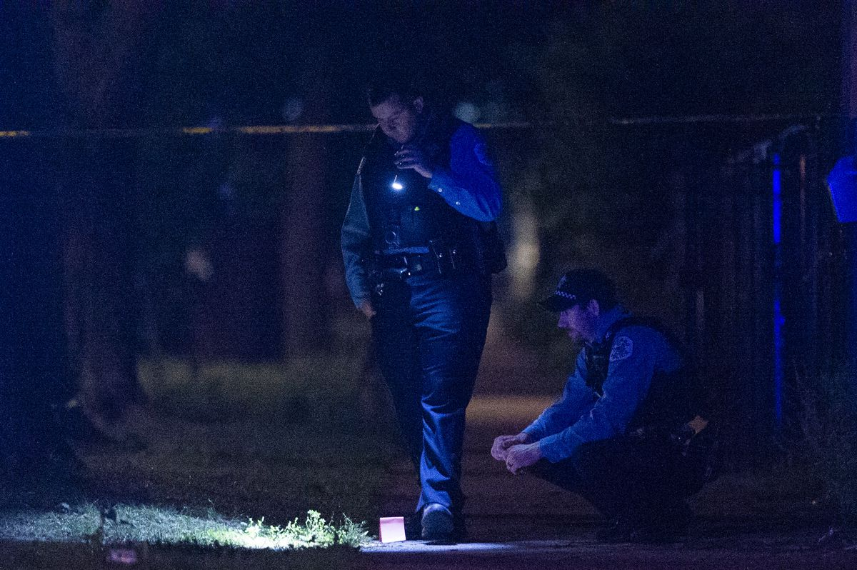 Police investigate the scene where a man was shot Friday morning near Independence and Fillmore.   Tyler LaRiviere/Sun-Times