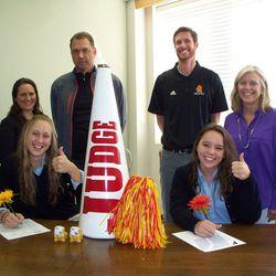 Judge volleyball players sign on Wednesday. Pictured from left to right:  Rachel Gondrezick with her parents Lisa Gondrezick and Gale Gondrezick; Brett Allen, Director of Athletics, Lauren Naatz and her mom, Paula Naatz.