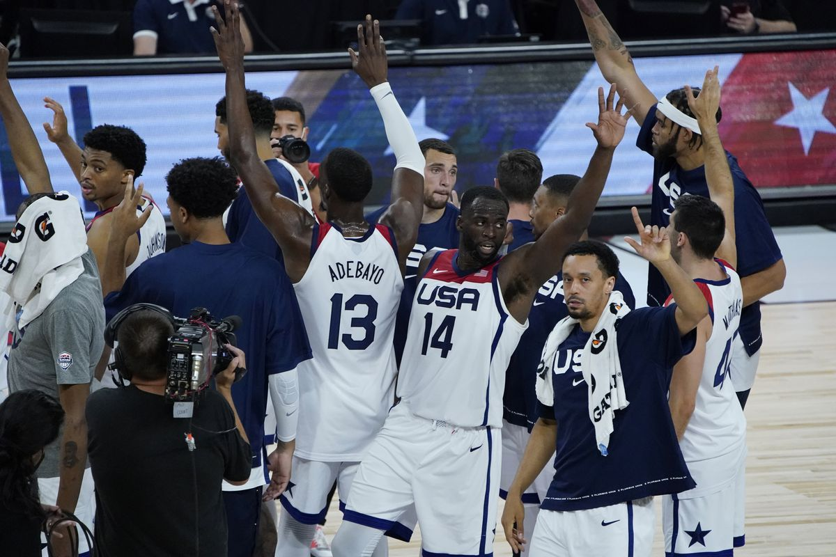 United States players celebrate after defeating Spain in an exhibition basketball game in preparation for the Olympics.