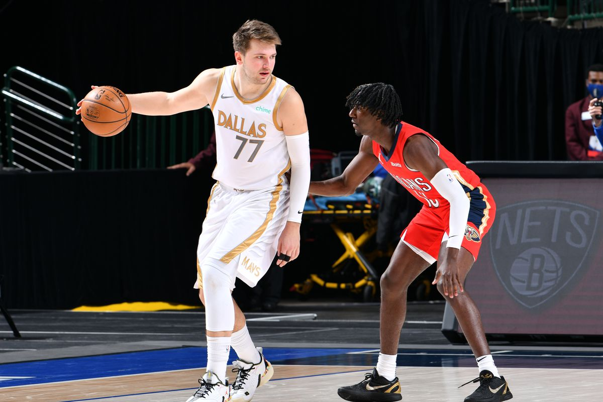 Luka Doncic #77 of the Dallas Mavericks dribbles the ball during the game against the New Orleans Pelicans on February 12, 2021 at the American Airlines Center in Dallas, Texas.